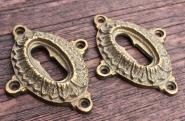 1 Paar historistische Schlüsselrosetten