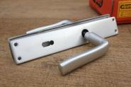 Alte Aluminium-Türdrücker der Firma Alpan